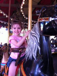 Olivias first carousel ride