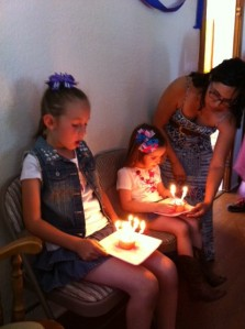 The birthday girls blowing out their candles