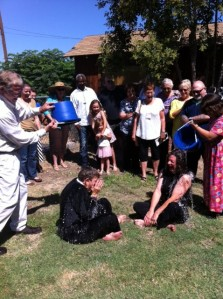 Our priest and deacon accept the Ice Bucket Challenge while Olivia, Lily, and the rest of the congregation look on encouragingly.