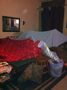 Tonight's tent, assembled with clothes pins, laundry baskets, and bedcovers.