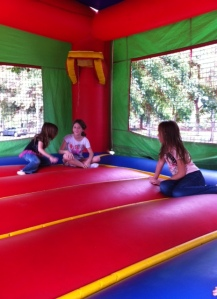 A bounce-house confab with a new friend