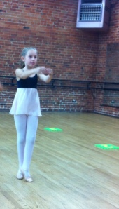 Lily towards the end of their dance.  The picture is lopsided because of how I needed to crop out her partner!