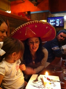 Georgia's birthday dinner at Tarasco's.  Whitney, Olivia, and Nick are looking on.