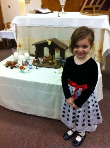 Olivia with the creche put together by the congregation of St. Paul's Episcopal Church - Visalia, this Christmas Eve.