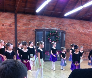 The dancers.  Lily is right beneath the Christmas wreath.