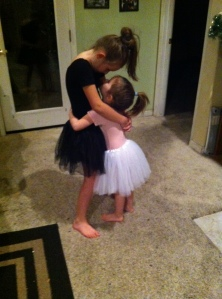 At the end of a lovely evening:  Hugs and kisses from Big Sister.