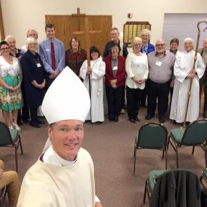 Bishop David Rice and those being confirmed and received