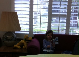 "Olivia reading the ""Forward Day By Day"" magazine to Pluto during today's annual meeting."