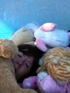 Don't I look comfy surrounded by Olivia's animals?