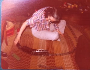 Mom and her Lionel train, Christmas 1980.