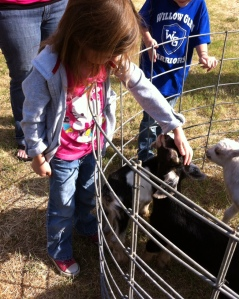Olivia loved petting the little kids.