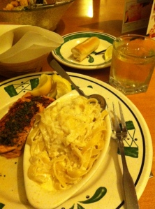 Herb-encrusted salmon, fettucchini Alfredo, the world's best breadsticks, and a Scotch and soda...who could ask for more?