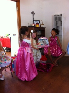 Olivia showing off a present.  Don't her friends look wonderful in their dresses?
