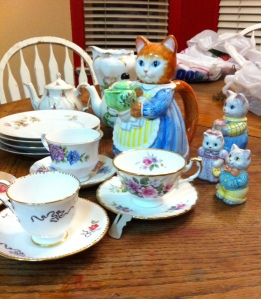 I have had this little Avon Momcat teapot and her kittens for many years.  It will be perfect for the party!