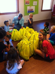 Our campers, Suzy, and the filled Samaritan Bags.