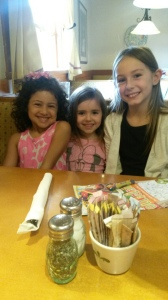 Kora, Olivia, and Lily ready to order their Olive Garden lunches.