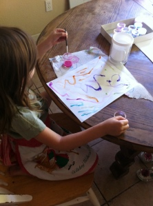 Olivia putting the finishing touches to her watercolor adventure.